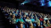A more sophisticated movie-going experience, with larger screens, elaborate special effects, recliner-like seating, upscale food options and alcoholic beverages, is what experts believe will keep the public filling theater seats.