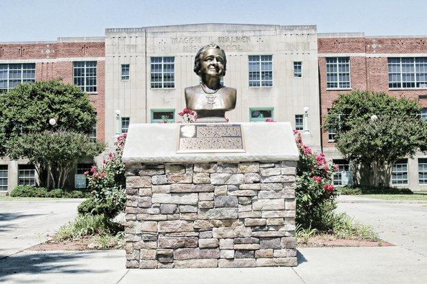 This bust of Richmond's great lady, Maggie L. Walker, sits on Lombardy Street in front of the regional Governor's School that bears her name.  Mrs. Walker, an advocate for civil rights and economic empowerment, is best known for being the first African-American woman to found and become president of a bank.  The school dedicated the bust last year in celebrating her 150th birthday on July 15. Members of the Maggie L. Walker Class of 2011 led the effort to raise the money for the commemorative bust.  It is a bronze replica of a plaster bust of Mrs. Walker that sculptor Paul Beneduce created in 1934 for Richmond's celebration of Maggie L. Walker Month, which took place two months before her death.