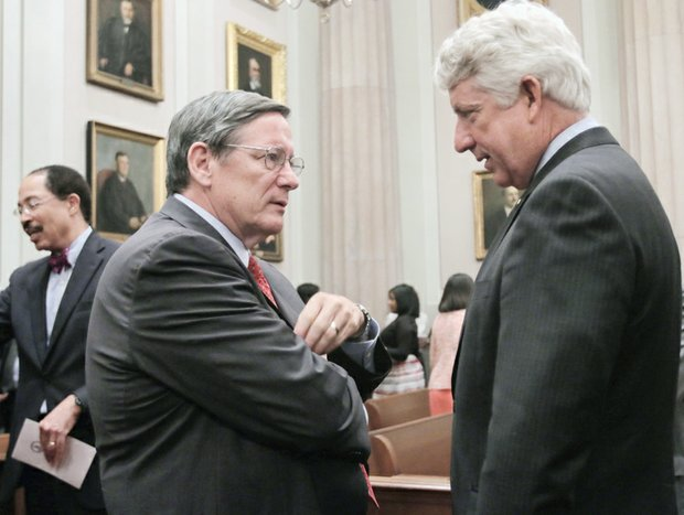 Chief Justice Donald W. Lemons, left, who presided at the court's special session, talks with Attorney General Mark R. Herring, who spoke at the court session commemorating the ODBA's 75th anniversary.
