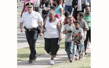 Richmond Police Chief Alfred Durham works at strengthening community ties by attending community meetings and leading anti-violence rallies, including this one May 12 in the Mosby Court public housing community.