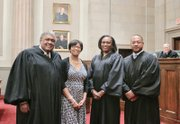 The Old Dominion Bar Association's annual conference opened last Thursday with a special session of the Supreme Court of Virginia, where the African-American justices who have served on the state's highest court were recognized. The honorees, left to right, retired Justice John Charles Thomas, Linda G. Hassell, widow of the late Chief Justice Leroy R. Hassell Sr., Justice Cleo E. Powell, and Justice S. Bernard Goodwyn.