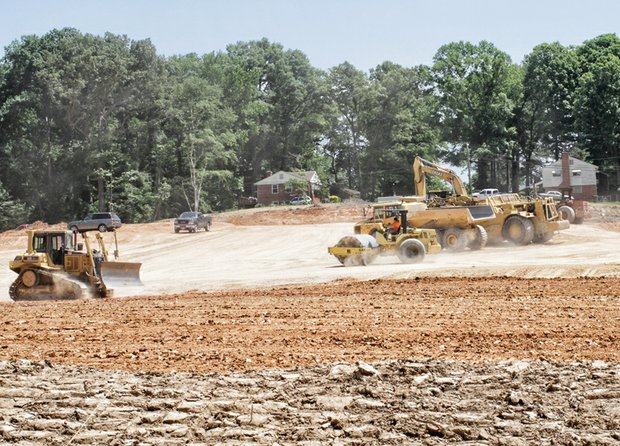 Heavy equipment prepares the ground for a new subdivision in South Side — fresh evidence that Richmond's housing market finally is rebounding from the great recession. The $14 million development, called Riverside Heights, is expected to result in 59 upscale townhouses in the 5700 block of Bliley Road near Stony Point Fashion Park. The subdivision, expected to feature three-bedroom townhomes starting at $220,000, won rezoning approval in July 2012. Ryan Homes is undertaking the development.