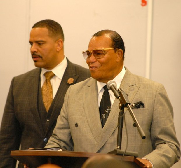 Min. Louis Farrakhan with son Mustapha speaking in Harlem last week.