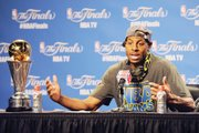 Golden State Warriors guard Andre Iguodala, above, talks about his selection as the NBA Finals MVP as he meets the media after the championship game Tuesday night in Cleveland.