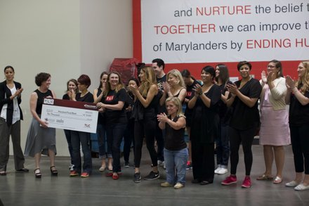 Vicki Lowell, EVP of Marketing for TLC, presented a $10K donation on behalf of TLC to Meg Kimmel, VP of Marketing and Communication for the Maryland Food Bank