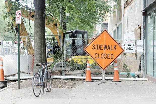 A portion of the sidewalk on the south side of Broad Street is closed to pedestrian and bicycle traffic as work progresses on the new Quirk Hotel. The development also will contain a new home for the Quirk Art Gallery. The 75-room luxury hotel is going into the nearly 100-year-old building at 201 W. Broad St. that originally was a department store. The gallery, now located a block west, is to fill 207 W. Broad St. The hotel-gallery is a project of Ted and Katie Ukrop. The hotel is projected to open in September.