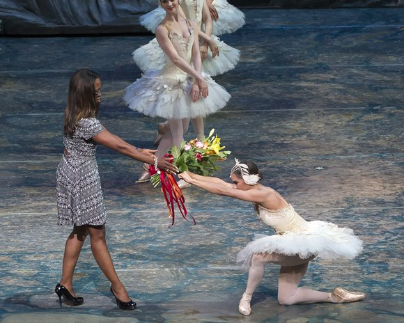 "As the opening strains of Tchaikovsky's ""Swan Lake"" filled the sold-out Metropolitan Opera House, a dancer in white flitted across ..."