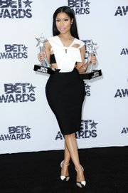 Nicki Minaj poses with her awards for Best Female Hip-Hop Artist and Viewers' Choice.