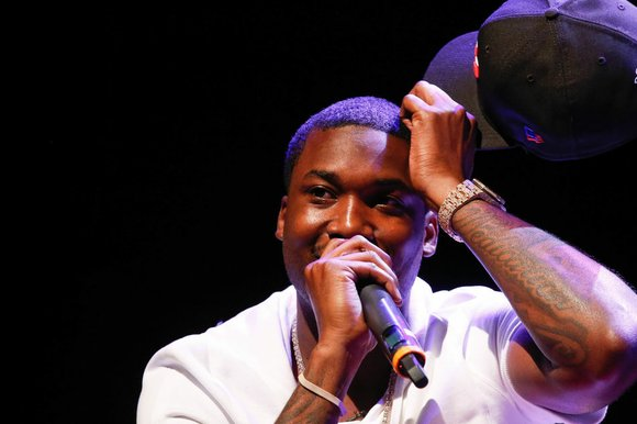 Meek Mill's probation officer is said to be giving him a hard time.