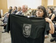 Shelly Lipscomb Echeverria proudly displays a shirt bearing the image of her ancestor, Delegate James F. Lipscomb, who represented Cumberland County from 1869 to 1877 in the General Assembly.