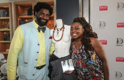 Ledisi (R) learned from Jay White (L) about aakofi the designer's custom fashions created with bold designs, fabricated using various precious metals gemstones leather and an array of up­-cycled materials.