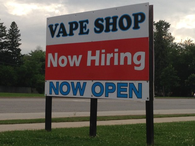 "A large board seeking employees for the newly opened Vape Shop on Plainfield Road in Joliet is just one of dozens of ""help wanted"" signs all over Joliet and other Will County towns, where the improving economy is spurring the need for more workers."