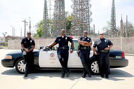 Where the Watts riots once erupted, LAPD officers use football to build bridges and battle crime. And that is a ...