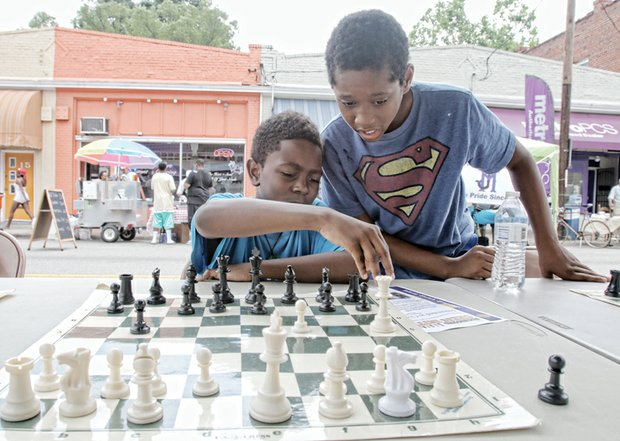 PAST, PRESENT COME TOGETHER AT HISTORY FESTIVAL - Caleb Penn, left, gets assistance from Khiri Nichols in planning his next chess move.