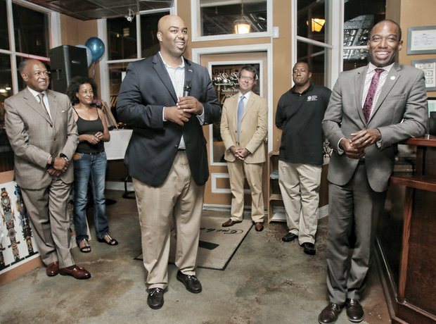 Lamont Bagby, the newest member of the House of Delegates, center, talks with supporters Tuesday night during his victory celebration at a Shockoe Bottom restaurant. They are, from left, Mayor Dwight C. Jones; restaurant owner Genet Semere; Grant Neely, the mayor's chief of staff; the Rev. Tyrone E. Nelson of the Henrico County Board of Supervisors; and Levar Stoney, secretary of the commonwealth