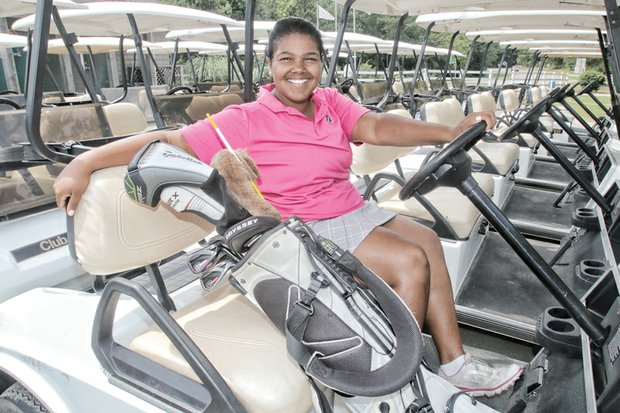 Golf champion Addie Parker, 15, credits her dad for starting her on the links when he ran out of partners to play with. She works this summer conducting golf clinics for youngsters at First Tee.