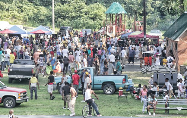 NORTH SIDE REUNION- Old friends — and new ones — gathered last Saturday in Battery Park for food and fun at the 23rd Annual Northside Re- union. Hundreds of people who live or once lived on the city's North Side shared in the good times.