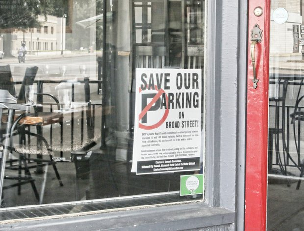 Business owners and residents along Broad Street and the Fan are posting signs protesting the loss of parking spaces on Broad Street because of GRTC's planned bus rapid transit.