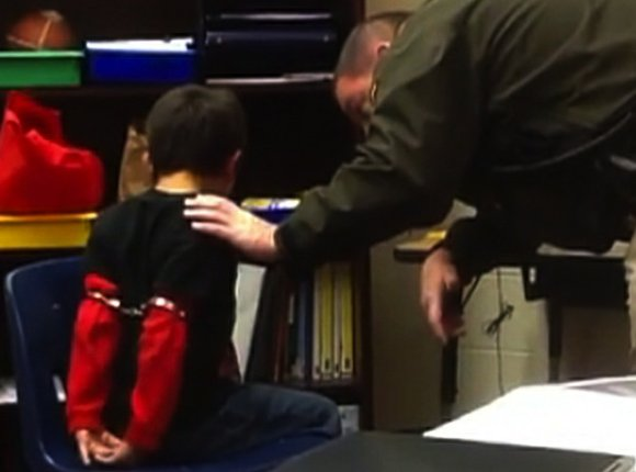A Kentucky sheriff's deputy now faces a federal lawsuit for handcuffing elementary school children who were acting out as a ...