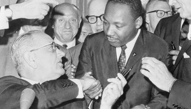 President Lyndon B. Johnson and Dr. Martin Luther King, Jr. at the Voting Rights Act signing
