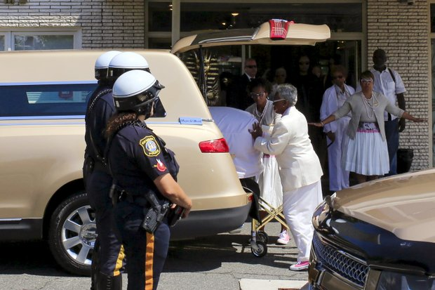 Whigham Funeral Home employees put the coffin of Bobbi Kristina Brown into a hearse Monday as they prepare to leave for the private burial in a Newark, N.J., cemetery. Both the burial and a memorial service last Saturday at a suburban Atlanta church were closed to the public and the media.