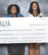 BUCKS FOR BOOKS - Tyshawna Hankerson, right, is all smiles as she and Tracey Oliver, vice president for administration at the Richmond Free Press, hold a ceremonial replica of the $1,000 book scholarship award to help Ms. Hankerson purchase books this fall when she enters Virginia Commonwealth University. The Free Press joined other area businesses and organizations to provide book scholarship awards through the KLM Scholarship Foundation Inc. More than $30,000 was awarded to 30 students from Virginia at last Saturday's awards ceremony at Linwood Holton Elementary School on North Side. Speakers included Kimberley L. Martin, who founded the Richmond-based nonprofit. It has awarded nearly $150,000 in book scholarships since its founding in 2002.