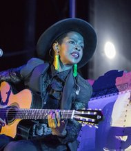 Richmond Jazz Festival brings the music to Maymont- Singer-songwriter Lauryn Hill demonstrates her range as she plays the guitar.