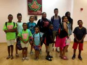 We're ready! These kids take time to pose with their new backpacks, which were full of school supplies, which were donated by Epsilon Omega Foundation, Inc. and Epsilon Omega Chapter of Alpha Kappa Alpha (AKA) Sorority.