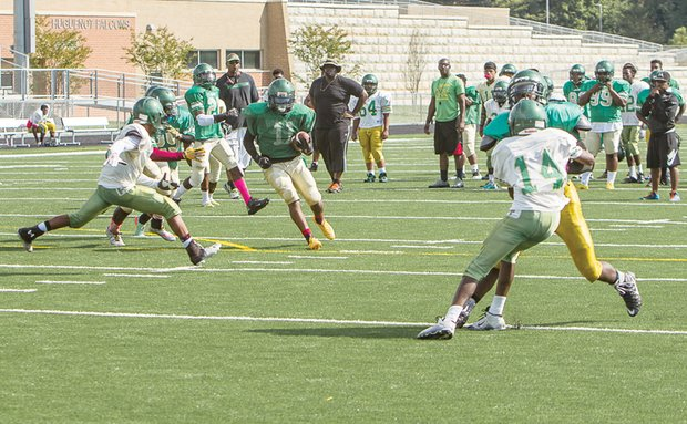 Huguenot Falcons work on offense and defense as they prepare to welcome Thomas Jefferson for the first home game on their new field Saturday.