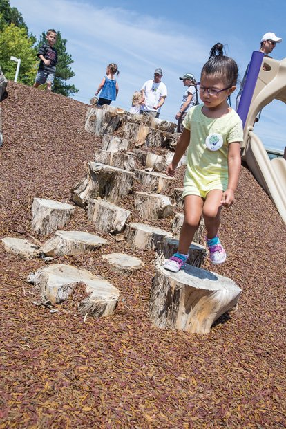 Fun at ARCpark - The sounds of happy children playing filled the air Saturday at the opening of the new ARCpark on North Side. Olivia Lynne Rios, 3, navigates a recreation trail.