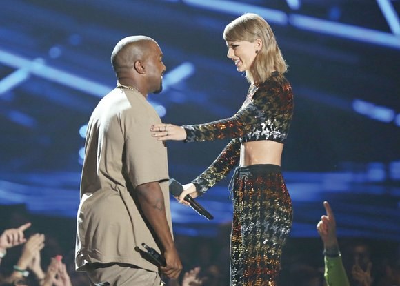 Taylor Swift may have won the most Moonmans on Sunday, but it was her reunion with rapper Kanye West on ...