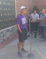 Baltimore Ravens head coach John Harbaugh speaks to the media before the team's first regular season practice.