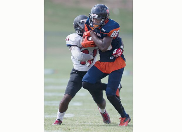 Virginia State University wide receiver Jaivon Smallwood (No. 80) is nabbed and stopped by Devonte Suber of California University of Pennsylvania.