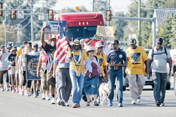 """'Journey for Justice' in Richmond --  Marchers on America's """"Journey for Justice"""" make their way along U.S. 1 in Ashland on route to Washington. The nearly 1,000-mile trek, organized by the national NAACP for justice, equality and voting rights, came through Richmond last week, where a rally and teach-ins were held."""