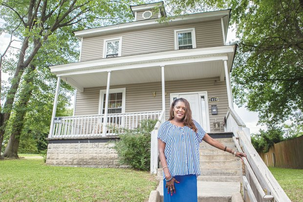 Gwendolyn H. MacClenahan stands in front of the Highland Park house she planned to turn into a group home where women released from prison could begin to rebuild their lives. Location: 2414 4th Ave.