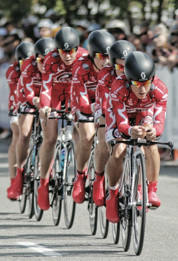 Racers from USA-based Team Pepper Palace Pro tightly wind along Lakeside Avenue in Henrico County on Sunday after the start of the Women's Elite Team Time Trial.