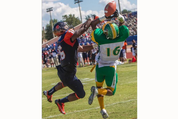 Virginia State University defensive back Malik Sexton, left, knocks away a pass intended for Kentucky State University receiver Bryan Henderson during last Saturday's game at Rogers Stadium in Ettrick. The Trojans won 14-7.