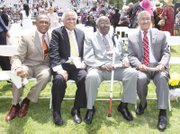 """VIPs surround Dr. Allix B. James, third from left, at Virginia Union University's 2012 Commencement. Seated with him at Hovey Field are, from left, Richmond Mayor Dwight C. Jones, a VUU alumnus; Raymond H. Boone, the late Free Press founder, editor and publisher; and U.S. Rep. Robert C. """"Bobby"""" Scott."""