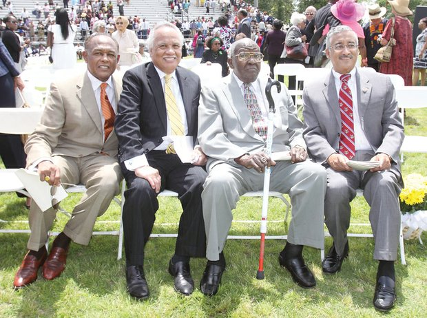 "VIPs surround Dr. Allix B. James, third from left, at Virginia Union University's 2012 Commencement. Seated with him at Hovey Field are, from left, Richmond Mayor Dwight C. Jones, a VUU alumnus; Raymond H. Boone, the late Free Press founder, editor and publisher; and U.S. Rep. Robert C. ""Bobby"" Scott."