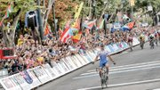 Peter Sagan of Slovakia triumphantly crosses the finish line at 5th and Broad streets Sunday as thousands of cheering, flag-waving, photo-taking fans acknowledge his win in the Men's Elite Road Race to complete the 2015 UCI Road World Championships.