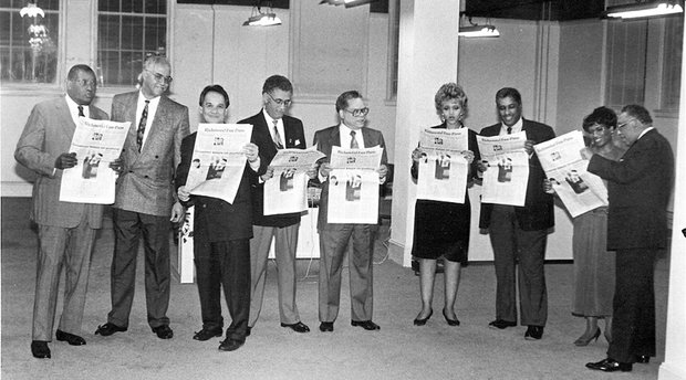 Dr. Allix B. James, left, checks out a prototype of the new Richmond Free Press with other members of the board of directors of Paradigm Communications Inc., which publishes the newspaper. Location: The newspaper's first newsroom at Broad and Adams streets in Downtown. Other board members, from left, Dr. Elwood Boone Jr., Free Press founder the late Raymond H. Boone, the late Dr. Darrel Rollins, the late Dr. William Thornton, Beverly Davis, Leonard Lambert, Dr. Lerla Joseph and Clarence L. Townes Jr.
