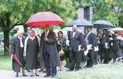 Dr. James' daughter, Portia James-Stubbs, leads family and close friends into the service, including Dr. James' goddaughter, former Richmond Circuit Court Judge Margaret P. Spencer and husband U.S. District Court Judge James R. Spencer, center.