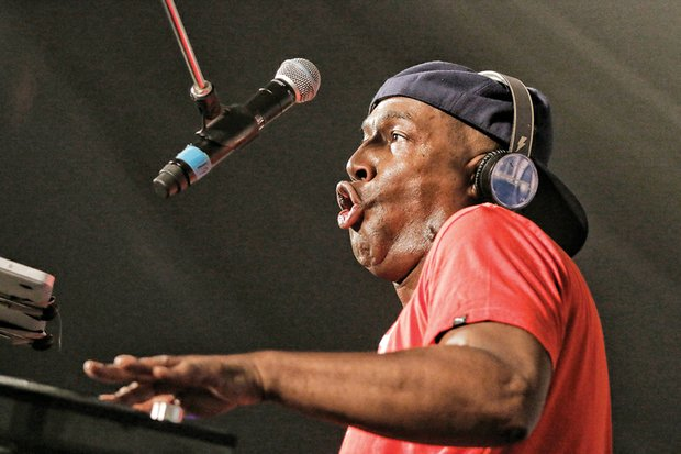 Hip-hop legend Grandmaster Flash delivers with energetic style, drawing a huge response, below, from enthusiastic fans.