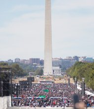 """Million Man March 20 years later - Throngs of people from across the nation flooded the National Mall in Washington for the Justice Or Else rally marking the 20th anniversary of the Million Man March. People of all ages, ethnicities, faiths and backgrounds were drawn to the capital for the event initiated by Nation of Islam leader Minister Louis Farrakhan. A number of speakers and activists addressed participants, calling for changes in the conditions that oppress African-Americans and other marginalized people. Coverage, B3. By Jeremy M. Lazarus Charlene C. Harris hoped to live out her years at 1600 Colorado Ave., the single- family brick cottage that she and her family have called home for 47 years. But now the retired 68-year- old state employee is being told she must either purchase the two-bedroom home from her landlord, the Richmond Redevelopment and Housing Authority, or face moving. """"It's a terrible situation,"""" she said. """"RRHA has told me I have to put up $500 to begin the process and to get a mortgage by December. Otherwise, I would have to accept relocation."""" Like other public housing tenants of such homes, she feels caught in a Catch-22. Until she puts up the $500, RRHA won't provide an appraisal that would let her know what the sales price would be so she could figure out if she could afford Sandra Sellars/Richmond Free Press Charlene C. Harris stands in front of her two-bedroom home in the West End. She has been told to buy it or face having to move. Location: 1600 Colorado Ave. RRHA residents in 'buy or move' spot the house on her fixed income of about $1,500 a month. It is an ironic twist that RRHA is now marking its 75th"""