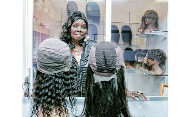 Mary J. Harris wants women to know the difference in wigs so they won't get taken. At left is a wig with a full-lace base. At right is a wig with a lace-front base, or lace on just a small portion.