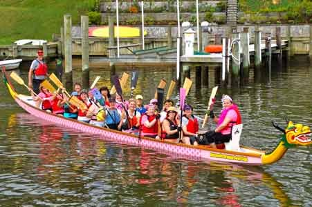 Twice a week club members— mostly women but some men— climb into two 44-foot long dragon boats and get a paddling workout along Spa Creek.