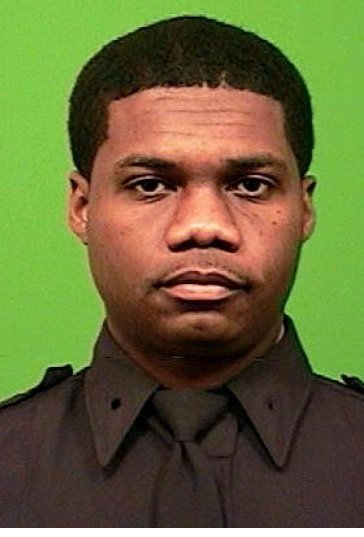 A police officer died after he was shot in the head while chasing a robbery suspect in New York, authorities ...
