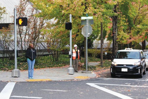 A new traffic signal is improving safety at the intersection of North Vancouver Avenue and Cook Street.