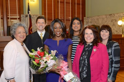 Flowers presented to Jacquie Baly by the Board of Directors of the Women Contractors Association (WCA)