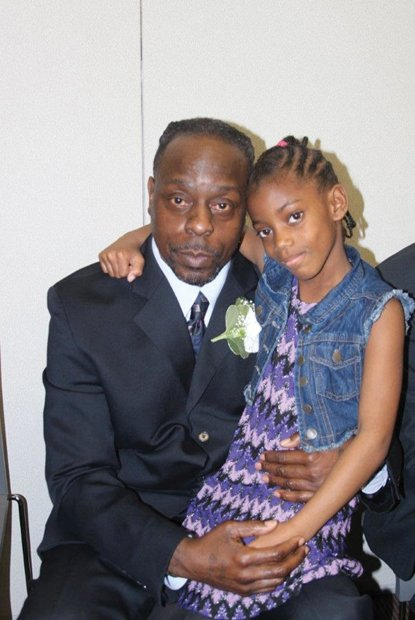 """Daddy's Home// Former Richmond Justice Center inmate Aziz Scott gained celebrity status this week when he was featured on two national television shows. He is pictured above with his 8-year-old daughter, De'Andra, at the 8th Annual Date with Dad Dinner and Dance at the city jail in March. He and his daughter were shown at the dance, organized by Richmond-based CAMP DIVA, on CNN's """"This Is Life With Lisa Ling"""" Wednesday and on the """"Steve Harvey"""" talk show Tuesday. The shows described Mr. Scott's participation in the jail's REAL program, which stands for Recovering from Everyday Addictive Lifestyles. Mr. Scott, 53, credits his participation in the program for helping him turn his life around. He was released from jail in August after serving 17 months for selling drugs. Assisting in efforts to help Mr. Scott succeed, Mr. Harvey presented him with a $5,000 check to relocate his family to a safer neighborhood."""
